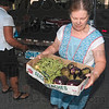 Tribune-Star/Joseph C. Garza<br /> Fresh from the garden: Linnea Snedeker, manager of the St. Patrick's Parish soup kitchen, carries vegetables into the kitchen that were donated by the Wabash Valley Master Gardeners Association Monday morning.
