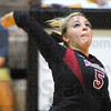 Taking aim: Knight Kayle Clark looks to spike against Mooresville.