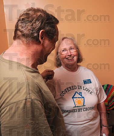 Tribune-Star/Joseph C. Garza<br /> A blessing to have as a friend: Muriel Ryan, the executive director and founder of Families by Choice, shares a laugh with handyman Phil Morin during the grand re-opening of Deborah's House Monday on south 11 1/2 Street. According to Ryan, Morin worked tirelessly on the home to restore it to a livable condition.