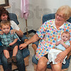 Tribune-Star/Joseph C. Garza<br /> Help for the new moms: Booker T. Washington High School student Kayla Harden holds her son, Jude Roberts, 2, on her lap, as nursery aide, Christine Travioli, holds four-month-old Hunter Sappington for his mom, Tori Bickers, Tuesday morning at the new school next to Terre Haute South High School.