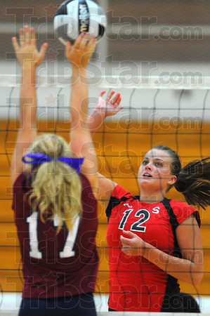 On the attack: Terre Haute South senior Taylor Hayne spikes againsat Bloomfield Monday evening.