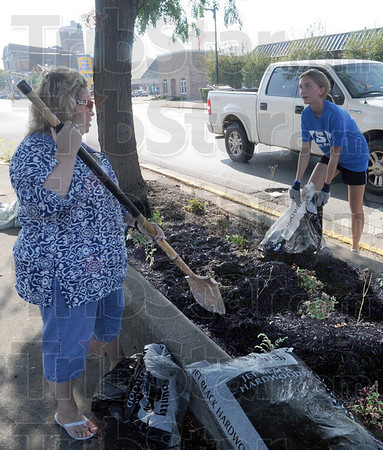 Mulch mates: Janice Board (L) and Nancy DeGott spread mulch in a flower box at 3rd and Wabash Tuesday morning as part of the annual Indiana State University Donaghy Day.