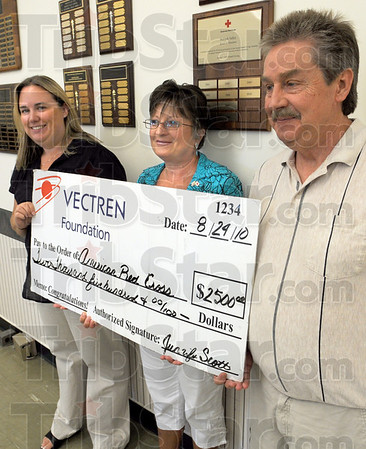 Check this: Jennifer Scott and Tim Hague present a check to Carol Stevens of the Red Cross Tuesday morning.