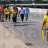 Walking: Local officials and community members join other participants in the Walk to Washington Tuesday afternoon as the cross the Wabash River bridge. The full-time walkers are headed to our nations' capitol to bring awareness to the problem of depression and are trying to get the stigma removed.