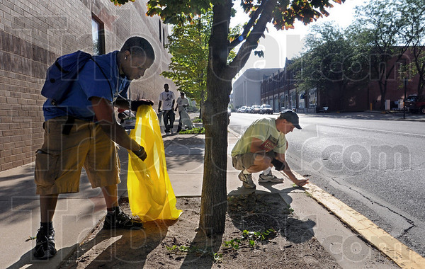 Donaghy: Indiana State University student George Nelson of Indianapolis works with Todd Nation (R) Tuesday morning during the annual Donaghy Day event. The pair are cleaning the area of 6th and Cherry Streets.