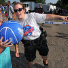 Over there: Caleigh Lenover takes directions fron Indiana State University police officer Heather Wade. Lenover is wearing goggles that distort her vision, making it difficult to make a basket.