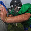 Foundation: West Vigo's Matt Flesher works with other linemen on his blocking skills. Flesher will also spend time at tight end.