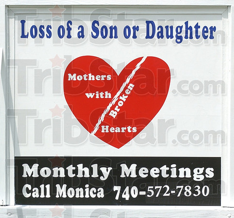 Reaching out: A sign board announcing the Mothers With Broken Hearts support group rests along SR63 south of Terre Haute.