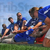 "Easy does it: Indiana State University athletic trainer Holly Schumacher is eased onto a backboard by fellow grad students during a collaborative exercise at Memorial Staduim Monday. Leading the team or ""rescuers"" is Amy McKenzie, right."
