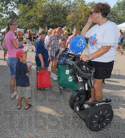 Meet and greet: Sue Meissel and her sons Ricky and Ethan along with family friend Parker Turpen chat with Terre Haute parking enforcement officer Michelle LaDow at the National Night Out Tuesday.