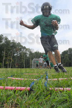 Foot drills: Dylan Aff hops through rope ladders as part of his training Monday at Viking football practice.