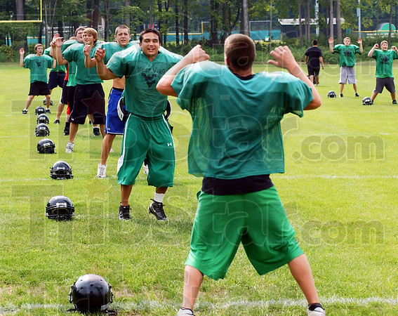 New season: The new football season started off with jumping jacks for the Vikings.