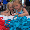 Choices: Taylor and Alexis Britt look over the bracelets provided by the Vigo County Juvenile Justice Center at the National Night Out at Fairbanks Park Tuesday evening. They attended the event with their parents Eddie and Autumn.