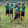 Practice makes perfect: West Vigo Head football coach Jeff Cobb encourages his players to stay low as they run through an agility drill Monday.