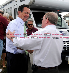 8/4/2010 Mike Orazzi | Staff Democratic Gov. candidate Dan Malloy greets Bristol Mayor Art Ward at the Shop Rite Plaza in Bristol during a campaign stop on Wednesday.