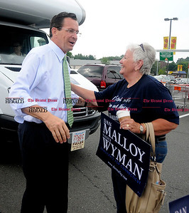 8/4/2010 Mike Orazzi | Staff Democratic Gov. candidate Dan Malloy greets Joella  Bouchard Mudry at the Shop Rite Plaza in Bristol during a campaign stop on Wednesday.