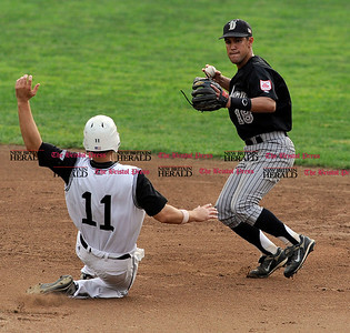 8/3/2010 Mike Orazzi | Staff Danbury's Alfredo Rodriguez (18) forces out Bristol's Joseph Martin (11) at second base during the NECBL game between Bristol and Danbury at Muzzy Field on Tuesday night.
