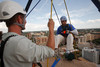 "(Denver, Colorado, Aug. 27, 2010)<br /> Caleb Bentsen guides Quinn Washington on his rappel.  ""Over the Edge,"" a benefit for the Cancer League of Colorado, at One Lincoln Park in Denver, Colorado, on Friday, Aug. 27, 2010.<br /> STEVE PETERSON"