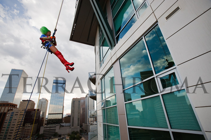 "(Denver, Colorado, Aug. 27, 2010)<br /> Nuclia Waste, in a Wonder Woman costume, rappels off the 28th floor.  ""Over the Edge,"" a benefit for the Cancer League of Colorado, at One Lincoln Park in Denver, Colorado, on Friday, Aug. 27, 2010.<br /> STEVE PETERSON"