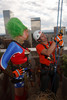 "(Denver, Colorado, Aug. 27, 2010)<br /> Caleb Vesely (right), an Over the Edge technical staff member, gives the Wonder-Woman-clad Nuclia Waste instruction on how to rappel off the 28th floor.  ""Over the Edge,"" a benefit for the Cancer League of Colorado, at One Lincoln Park in Denver, Colorado, on Friday, Aug. 27, 2010.<br /> STEVE PETERSON"