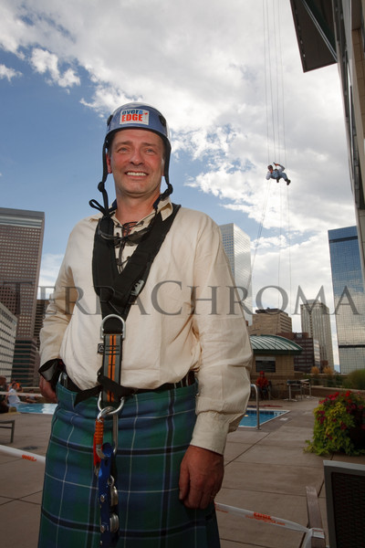 "(Denver, Colorado, Aug. 27, 2010)<br /> Andrew Thorburn, deputy director at the University of Colorado Cancer Center, just finished his rappel.  ""Over the Edge,"" a benefit for the Cancer League of Colorado, at One Lincoln Park in Denver, Colorado, on Friday, Aug. 27, 2010.<br /> STEVE PETERSON"