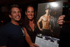 (Denver, Colorado, Aug. 28, 2010)<br /> Nicole Benjamin (right) gets a Fired Up for Kids firefighter calendar signed by Mike Conner (January 2012).  Celebrity Waiter event, a Concerts for Kids benefit, at Shanahan's Steak House in Denver, Colorado, on Saturday, Aug. 28, 2010.<br /> STEVE PETERSON