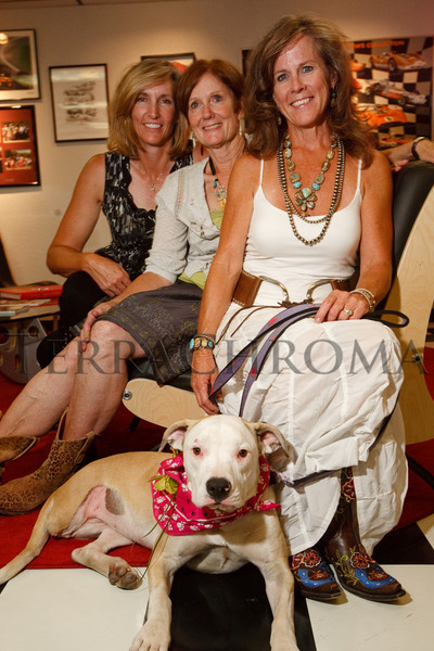"(Arvada, Colorado, Aug. 28, 2010)<br /> Beth Parish, Lynn Raber, and Moni Piz-Wilson with Pinky, an American Staffordshire terrier.  ""Raise the Woof,"" a benefit for the Foothills Animal Shelter, at The Mathews Collection in Arvada, Colorado, on Saturday, Aug. 28, 2010.<br /> STEVE PETERSON"