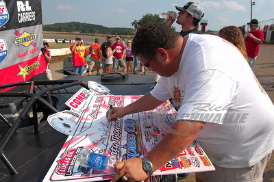 Batesville Motor Speedway Promoter - Mooney Starr signs the check for the COMP Cams Topless 100