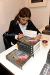 """NEW YORK-MARCH 11: Maha Akhtar signs book for guest at book presentation """"La nieta de la Maharaní"""" by MAHA AKHTAR hosted by CERVANTES INSTITUTE on Thursday, March 11, 2010 at Instituto Cervantes New York 211 East 49th Street, New York, NY 10017 (PHOTO CREDIT:  ©Manhattan Society.com 2010 by Christopher D. Mejia London)"""