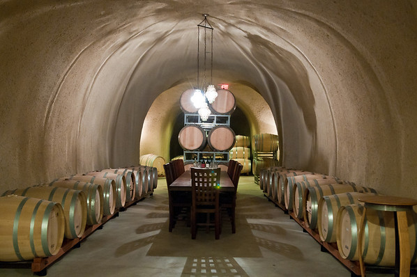 The caves at Jerich Canyon Vineyards. We had to call to make a reservation and drove up to this scary lookin' gate. The gate code was written on the door so I entered it, we drove in and finally found the winery after getting a little lost. The pourer was very nice and we tasted 3 of their wines (I took a Merlot home). Yum! These are their caves where they store the barrels for aging.