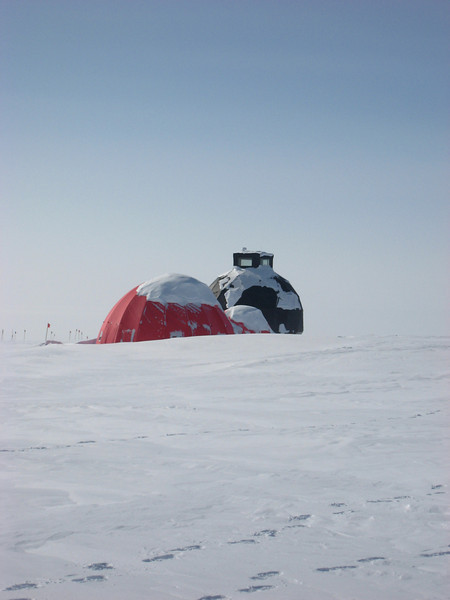 The main dome (black) and a dome for sleeping (red), when arriving at camp in the beginning of the season a lot of snow shoveling is necessary<br /> <br /> Photo: Theo Jenk