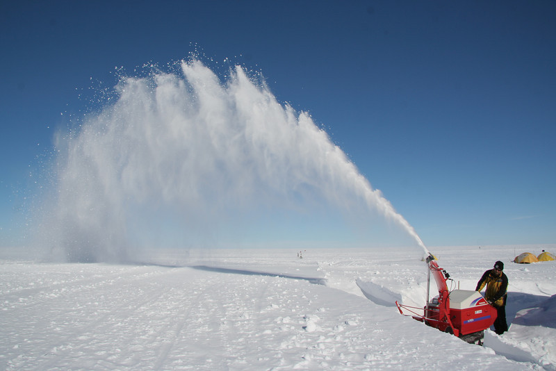 Removing drifting snow around the buildings is done regularly<br /> <br /> Photo: Marie Kjaergaard