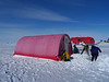 Putting up yet another tent for sleeping and removing snow around it<br /> <br /> Photo: Sepp Kipftstuhl