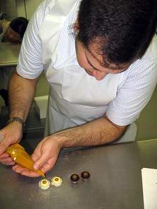 Craig pipes fresh mango and passionfruit filling into chocolate shells
