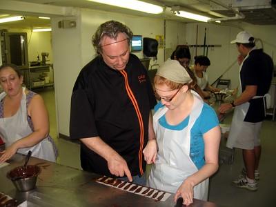 Chef Poulain critiques Laura's work