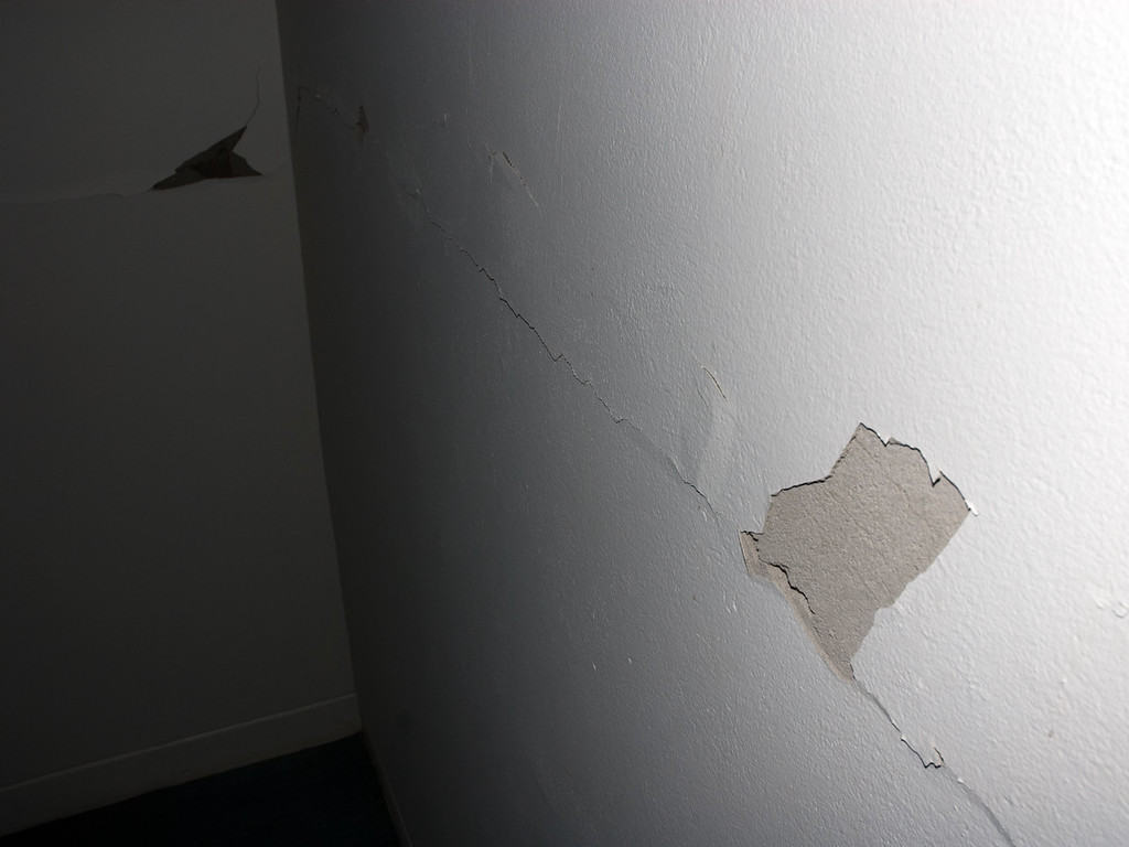 Cracked walls from aftershocks on level 7 at Wynn-Williams law firm.