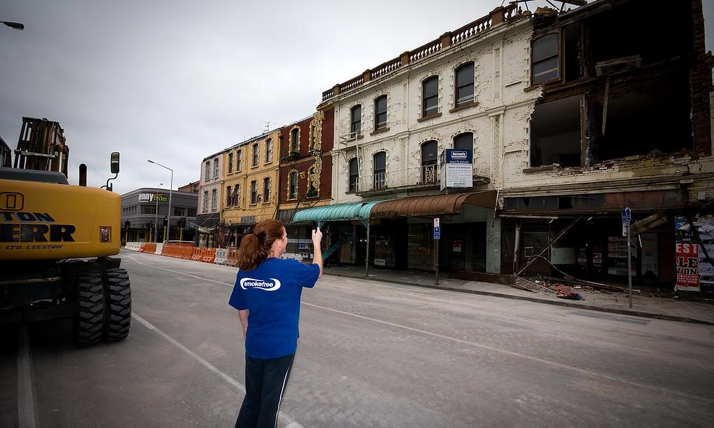 Shop owner photographs damage to derelict buildings
