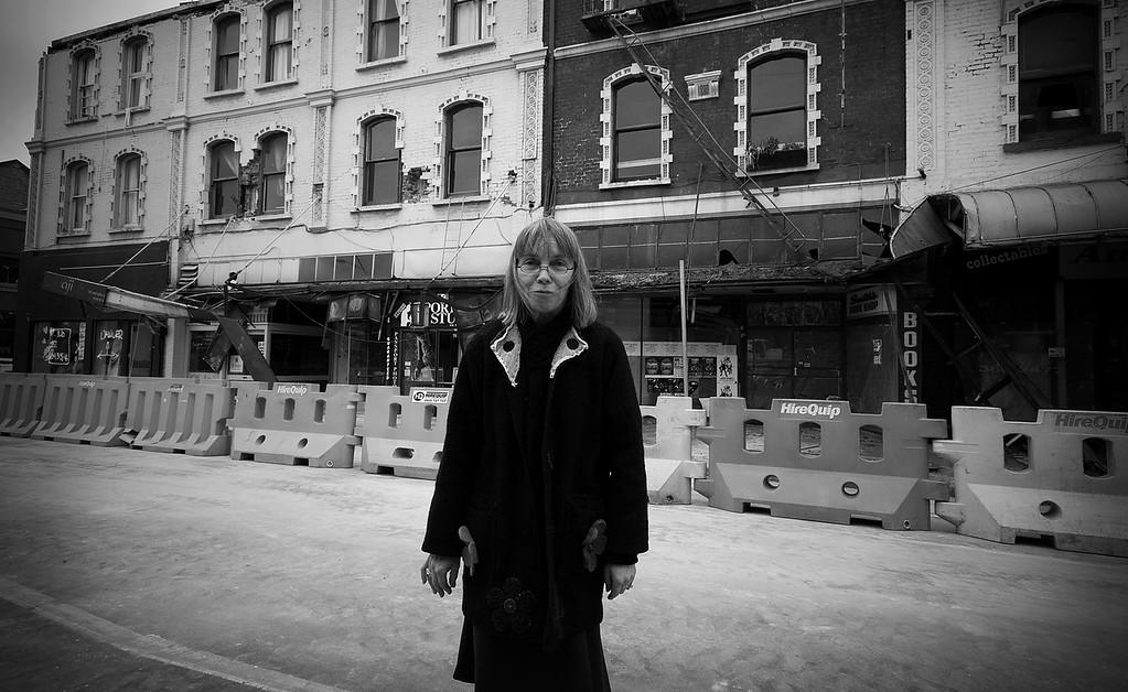 Local storeowner views damage to her neighbourhood