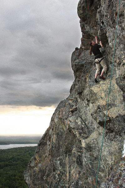 Shasta moves into an overhanging jughaul that marks the beginning of this route's crux.