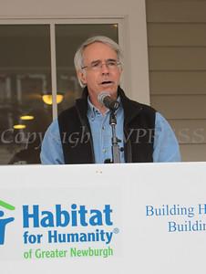 Bill Murphy, Habitat Newburgh Board member & House Captain addresses those gathered for the Habitat for Humanity of Greater Newburgh quintuple dedication on Sunday, April 18, 2010 in Newburgh, NY. Hudson Valley Press/CHUCK STEWART, JR.