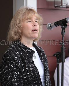Ellen Levine addresses those present on East Parmenter Street as Habitat for Humanity of Greater Newburgh held a quintuple dedication on Sunday, April 18, 2010 in Newburgh, NY. Hudson Valley Press/CHUCK STEWART, JR.