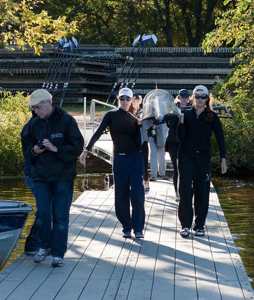 Girls varsity four on the dock
