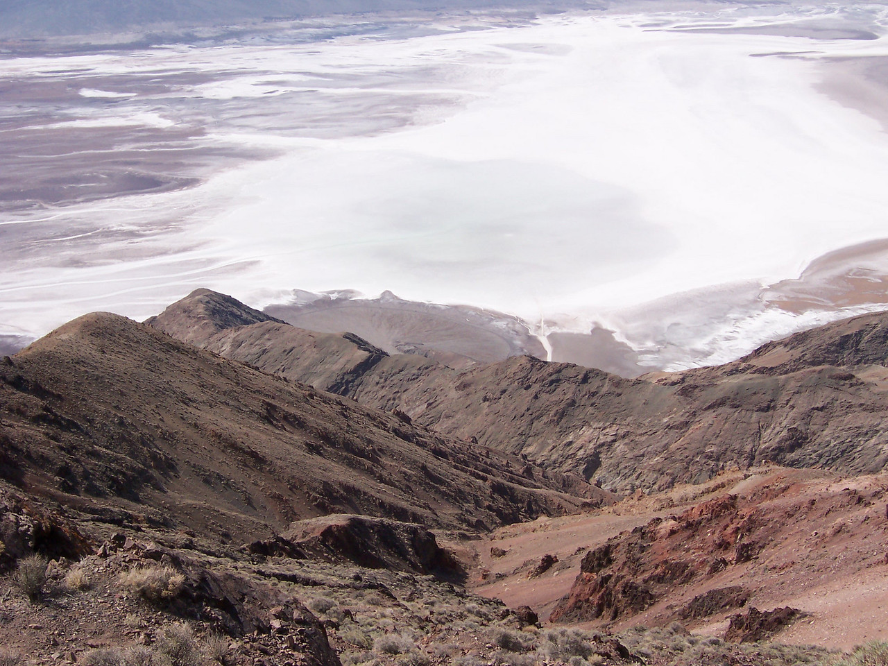 The Badwater Road over 5000' below and one mile away.