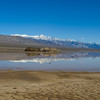 Telescope Peak and the Panamint range, reflected in a seasonal lake.