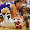 Under attack: Sullivan's????? ties up Patriot center Jade Rakes(22) in front of the Terre Haute North bench.