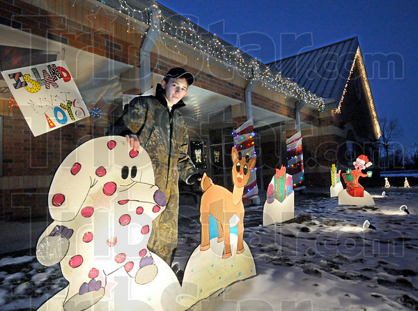 Light show: Brandon Kaperak is the designer and builder of the Christmas light decorations on the Gibault School campus. He's doing the project as part of his Eagle Scout requirements.