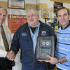 Award: Thomas Moore Sr. is presented the 2011 NAPA/ASE Technician of the Year Award Thursday afternoon at his southside business, Sir Thomas Auto Repair. Presenting the award is Wayne Benston (L) and Bob Wilde.