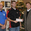 Big hearts: Ben Zobrist, president, and Stephen Owen, treasurer, of the Rose-Hulman Cecil B. Lobo student chapter of the American Society of Civil Engineers, present a check for over $2,400 for the Tribune-Star Christmas Basket Fund. Recieving the check on behalf of the Tribune-Star is editor Max Jones.
