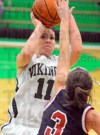 Taking aim: Viking junior Brooklyn Waters shoots past Terre Haute North defender Morgan Seely in second half action Thursday night in the West Vigo gym.