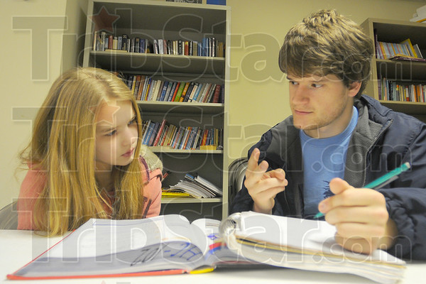 Math is tough: Honey Creek Middle School student Lyndsey Fell gets help with her math skills from Rose-Hulman Mechanical Engineering major Bryan Buccieri. The two were at the Hyte CenterThursday.